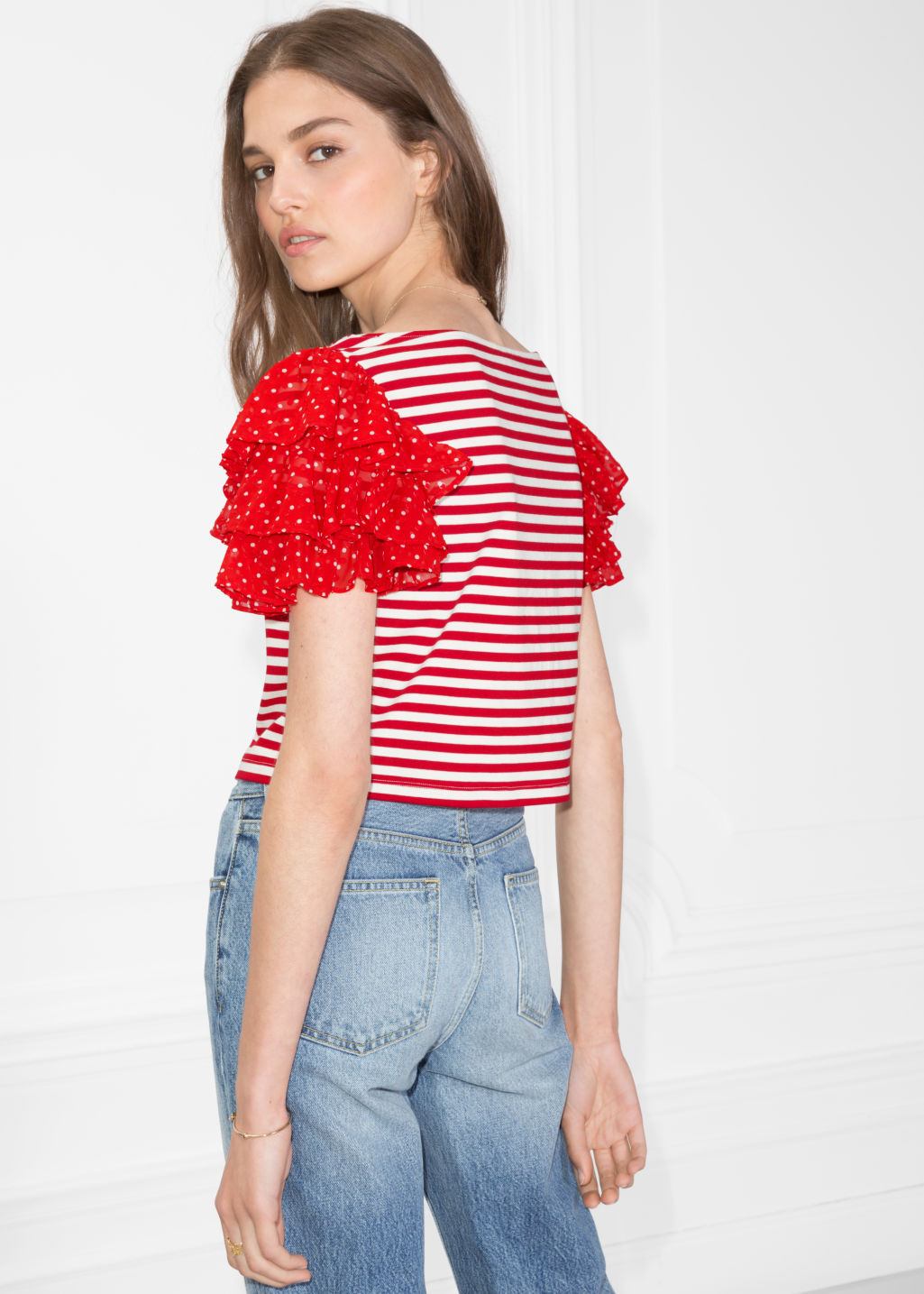 Model back image of Stories ruffle sleeve jersey top in red