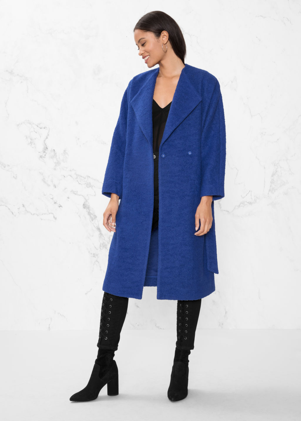Model front image of Stories oversized wool coat in blue