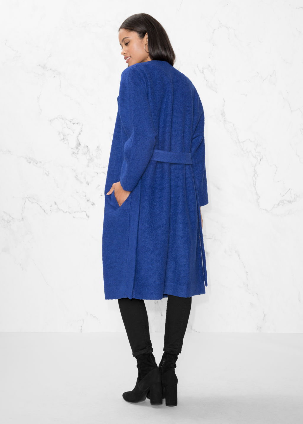 Model back image of Stories oversized wool coat in blue
