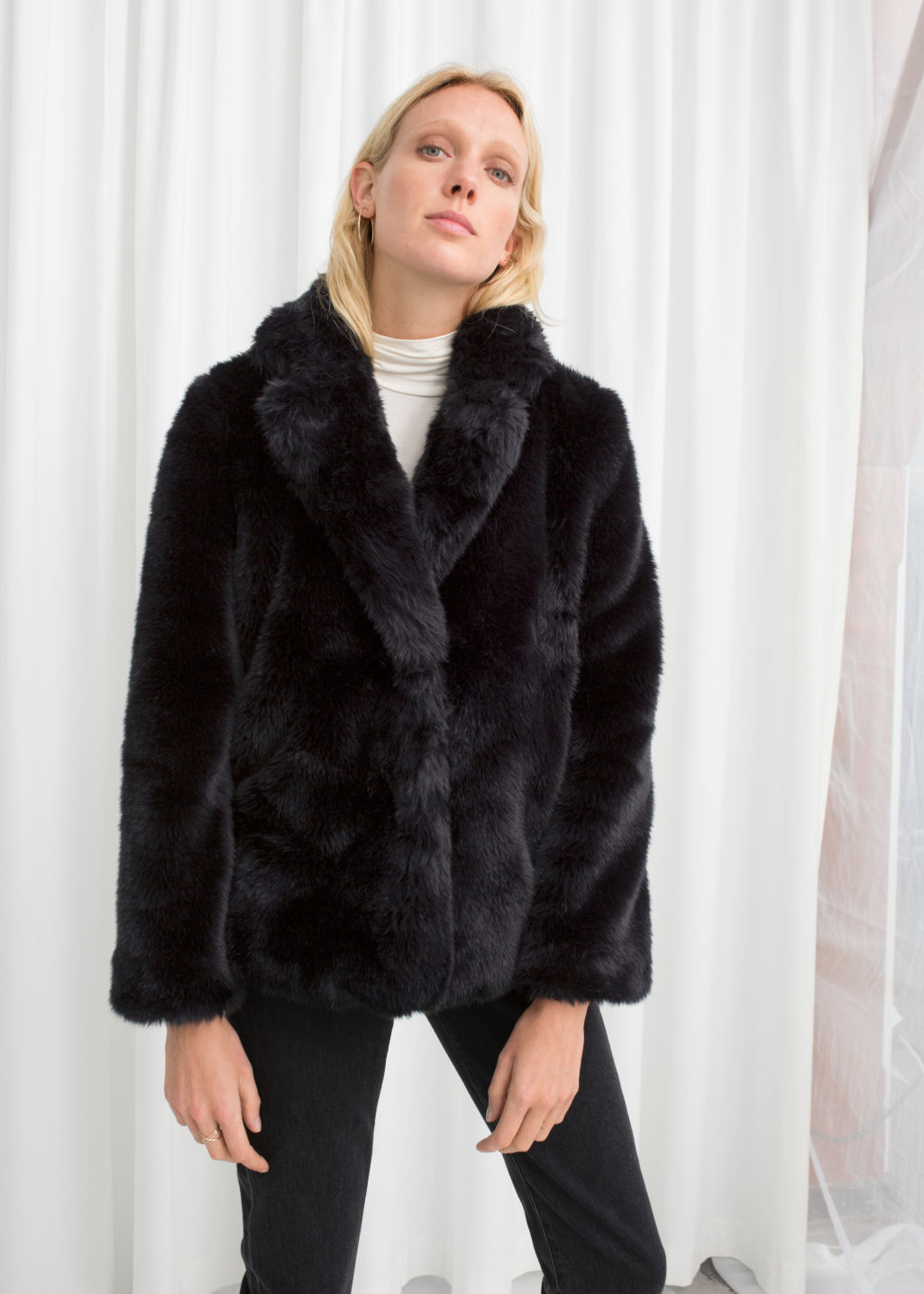 Model front image of Stories faux fur jacket in black