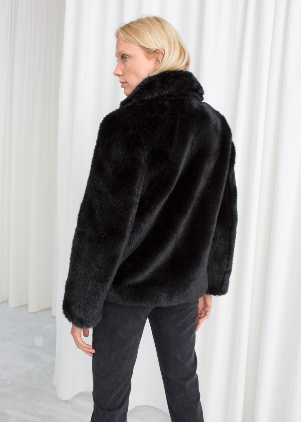 Model back image of Stories faux fur jacket in black