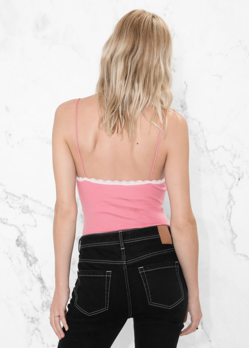 Model back image of Stories lace trim bodysuit in pink