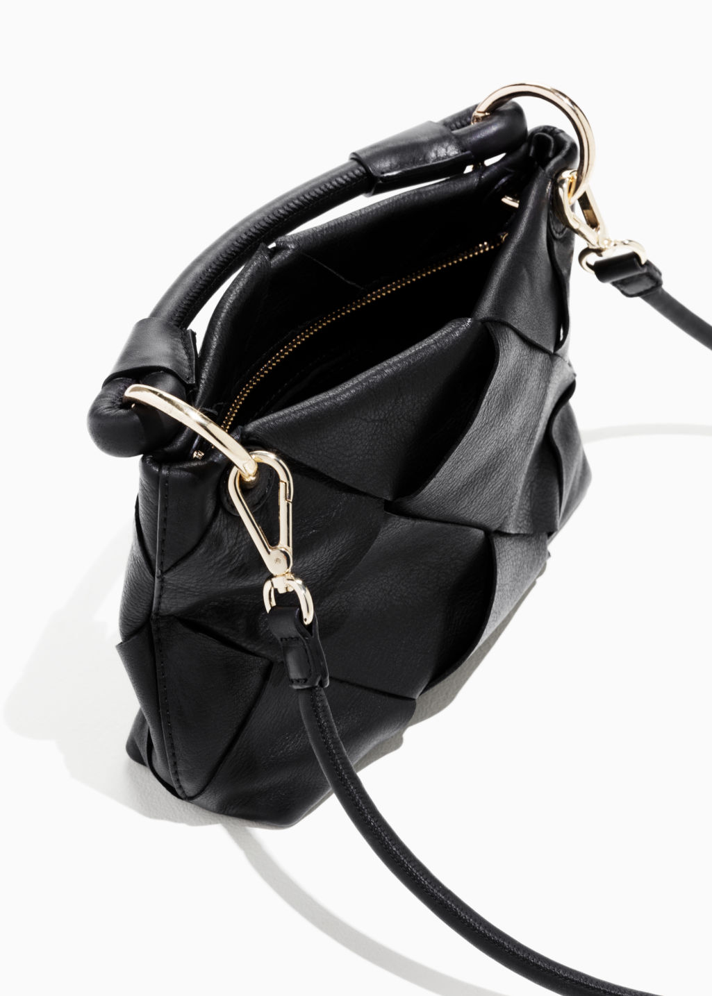 Model back image of Stories braided leather crossbody in black