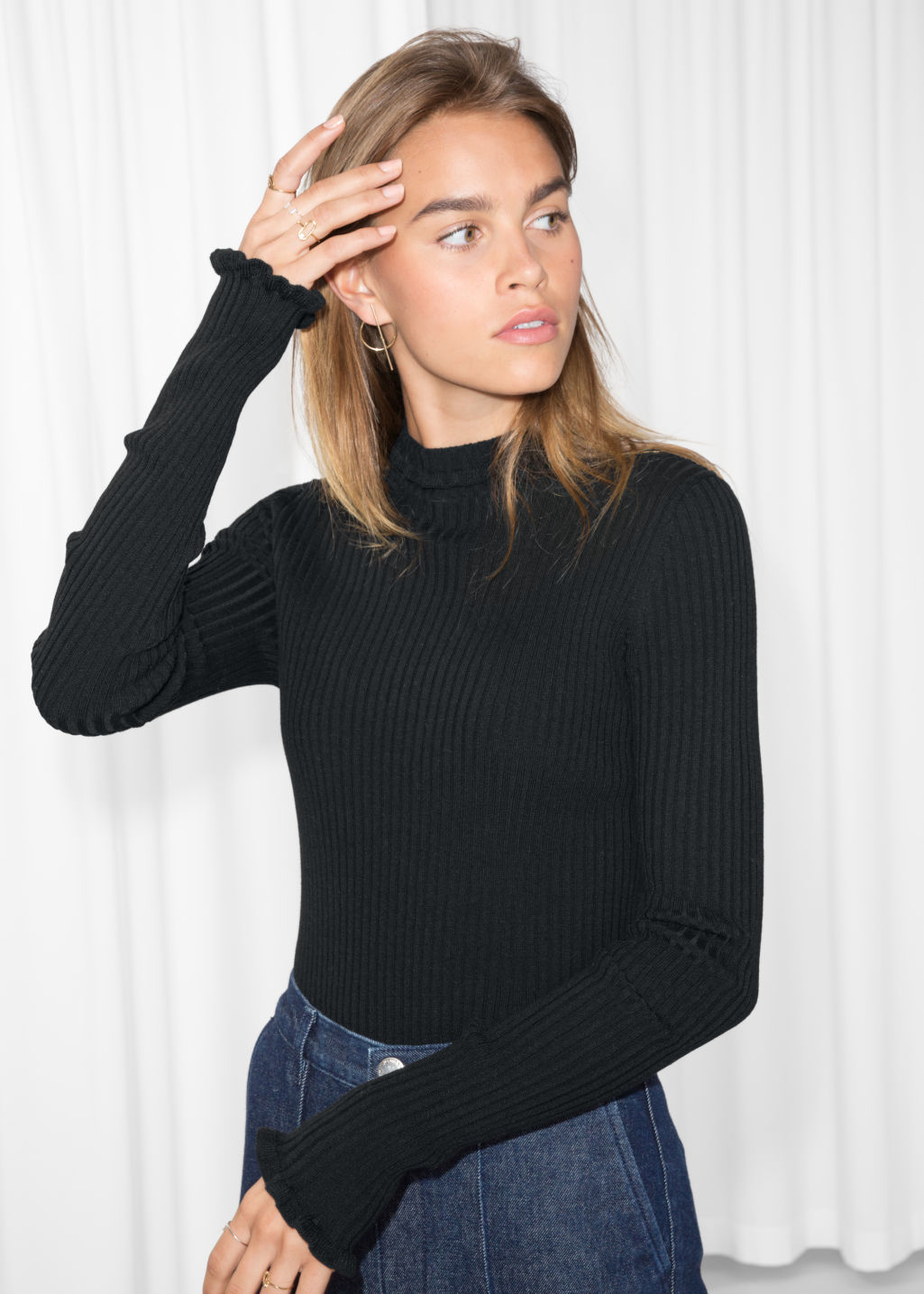 Model front image of Stories ruffles and ribbed turtleneck in black