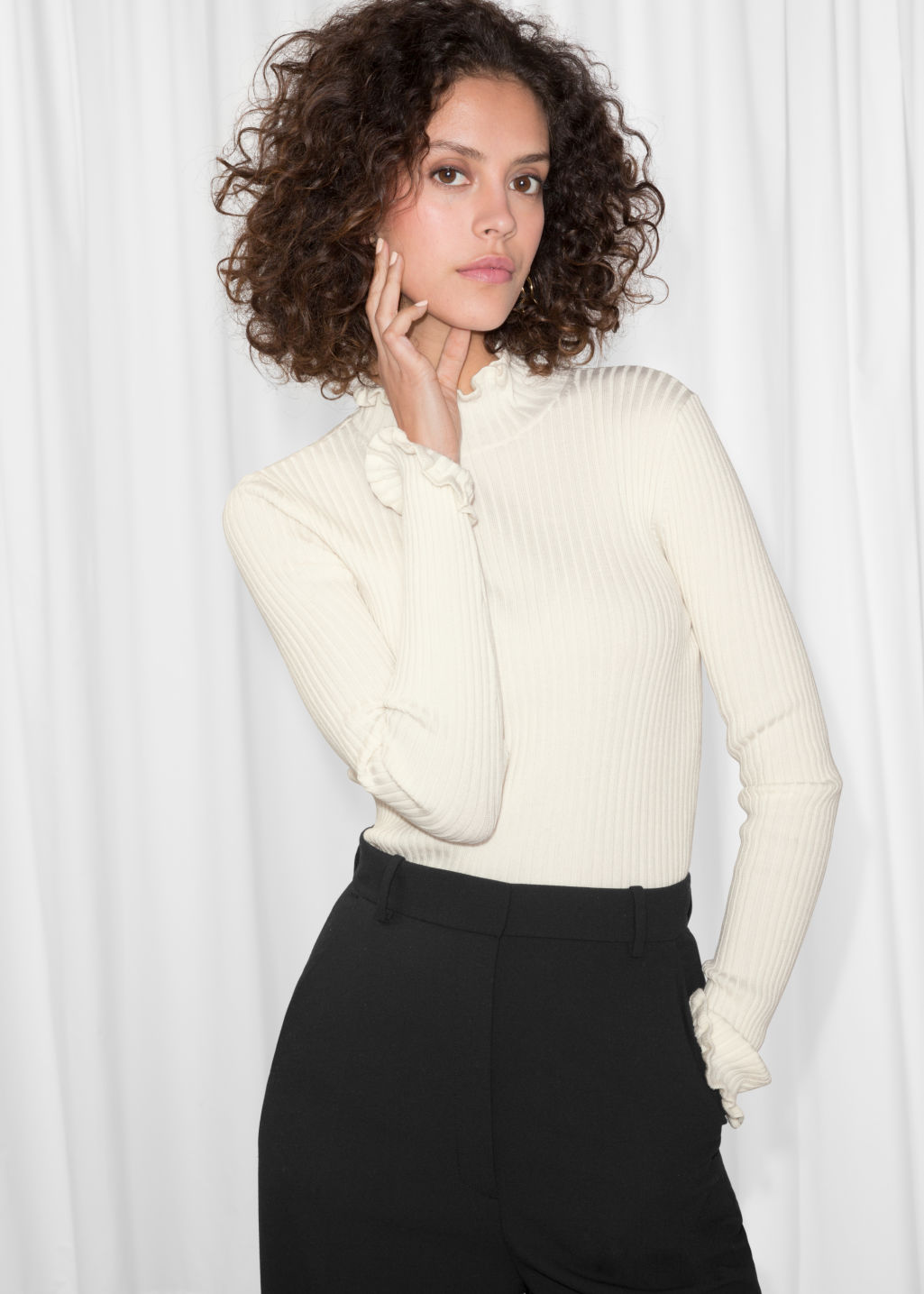 Model front image of Stories ruffles and ribbed turtleneck in white