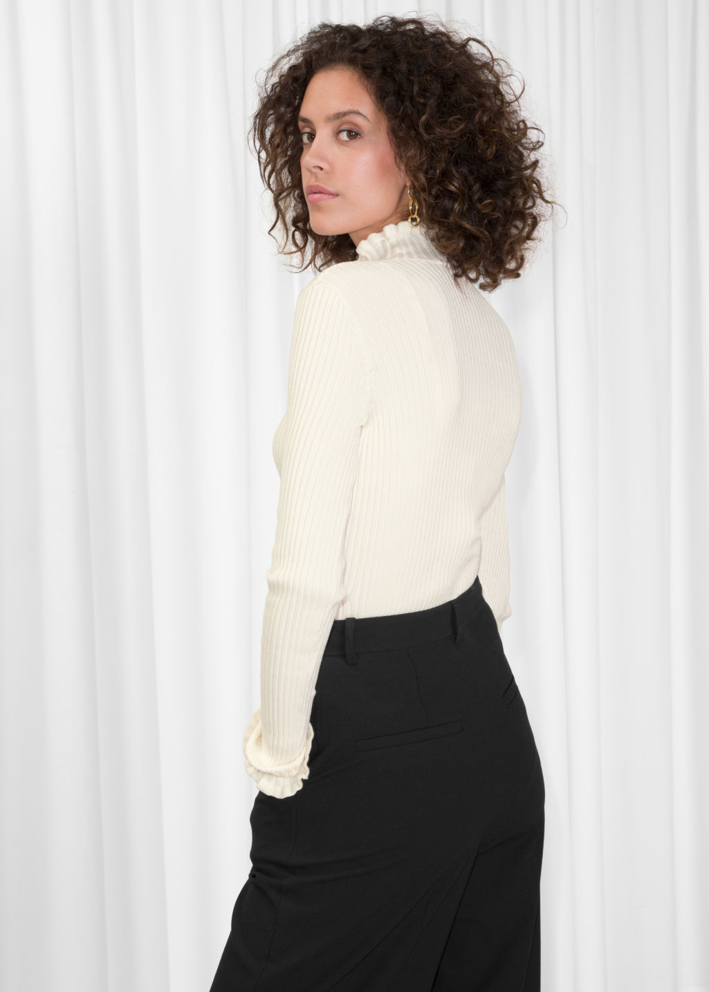 Model back image of Stories ruffles and ribbed turtleneck in white