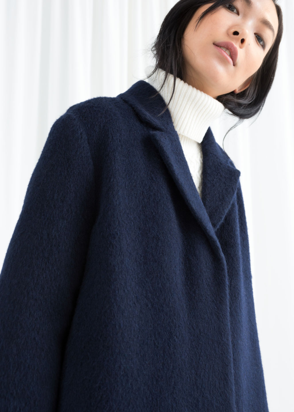 Model front image of Stories wool blend long coat in blue