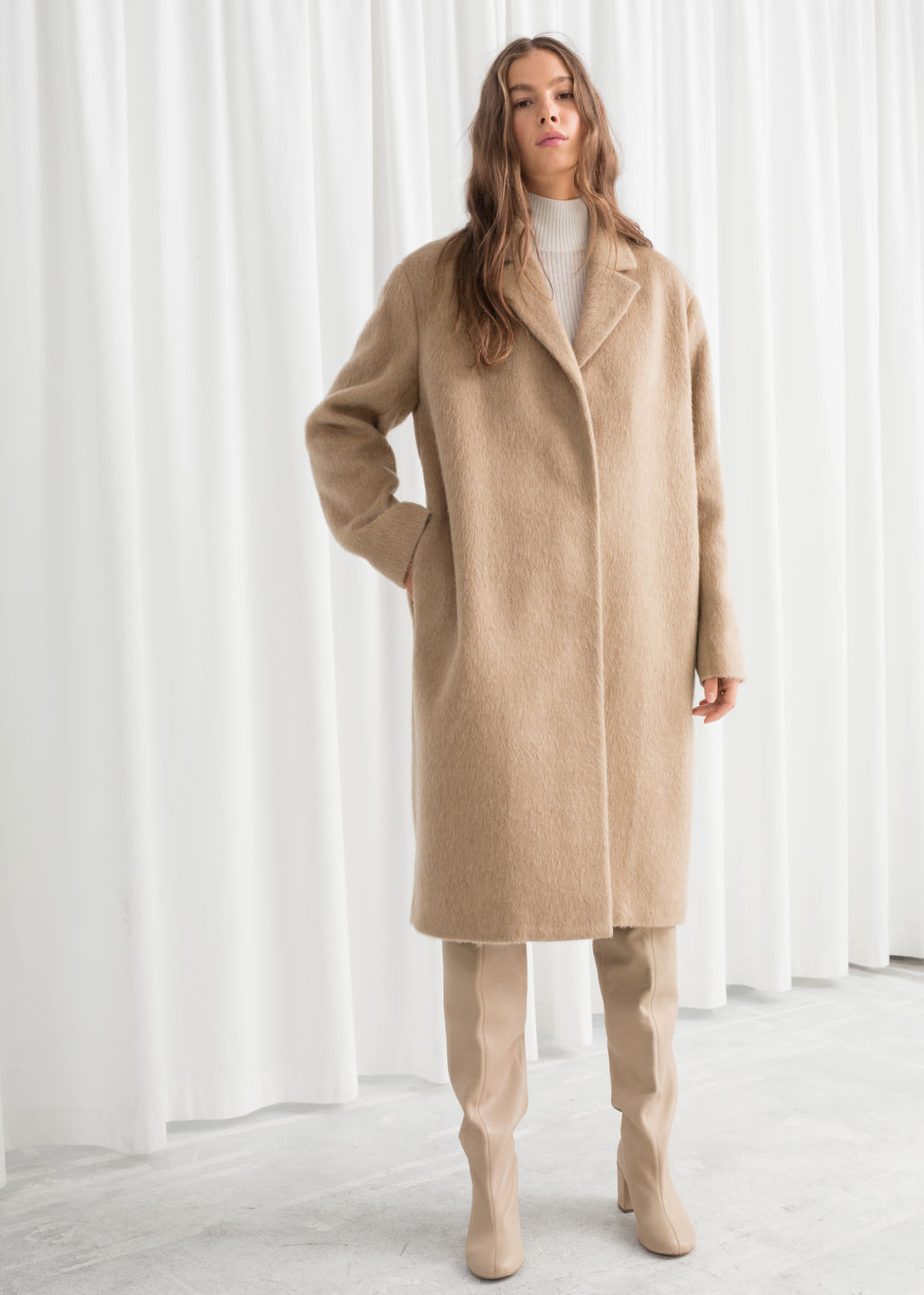 Model front image of Stories wool blend long coat in beige