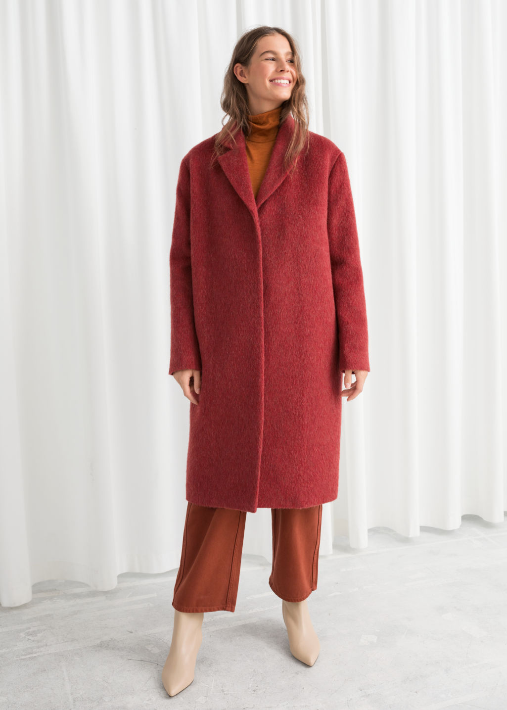 Model front image of Stories wool blend long coat in red
