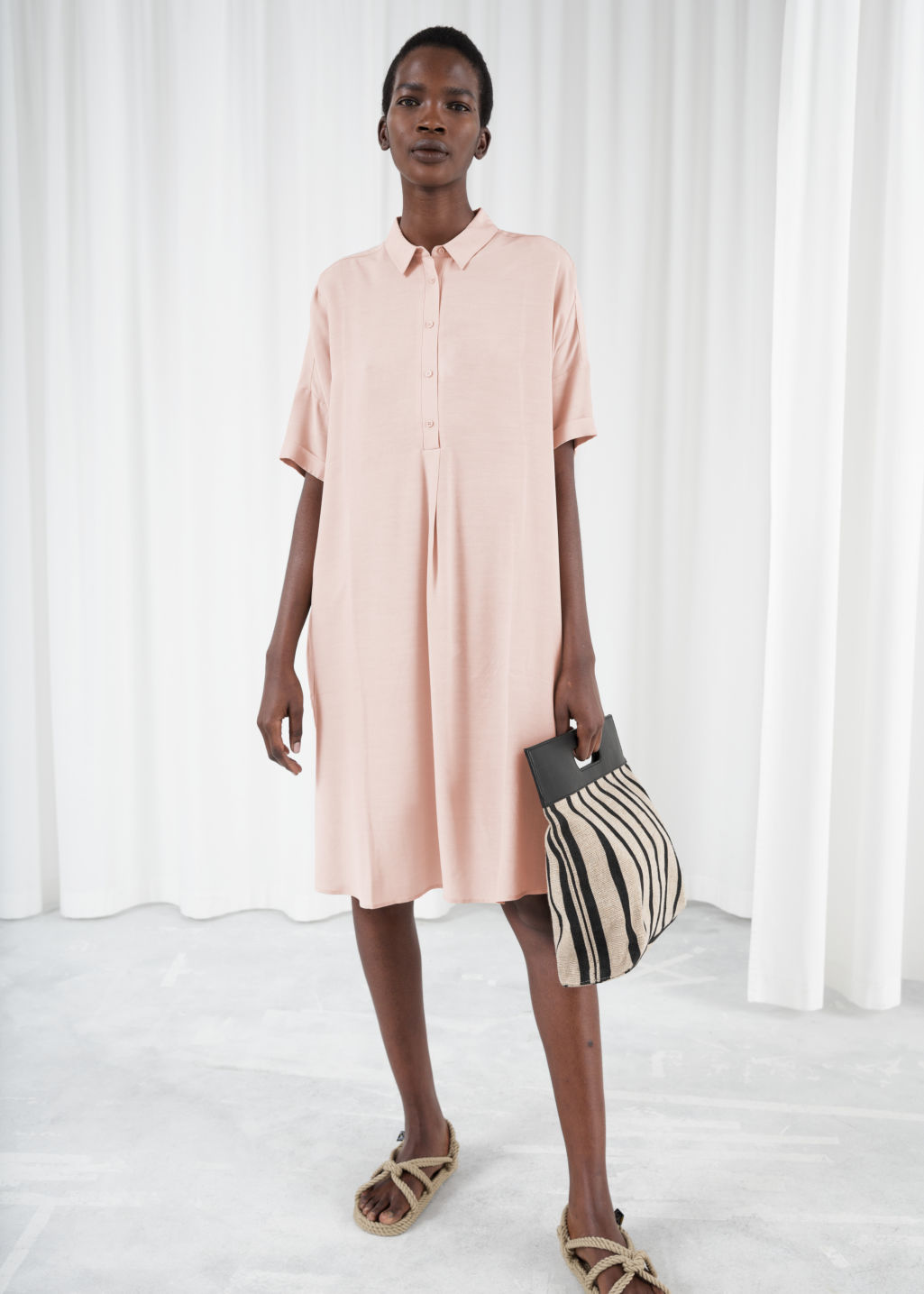 Model front image of Stories oversized shirt dress in beige