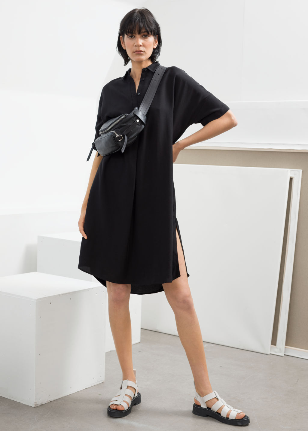 Model front image of Stories oversized shirt dress in black