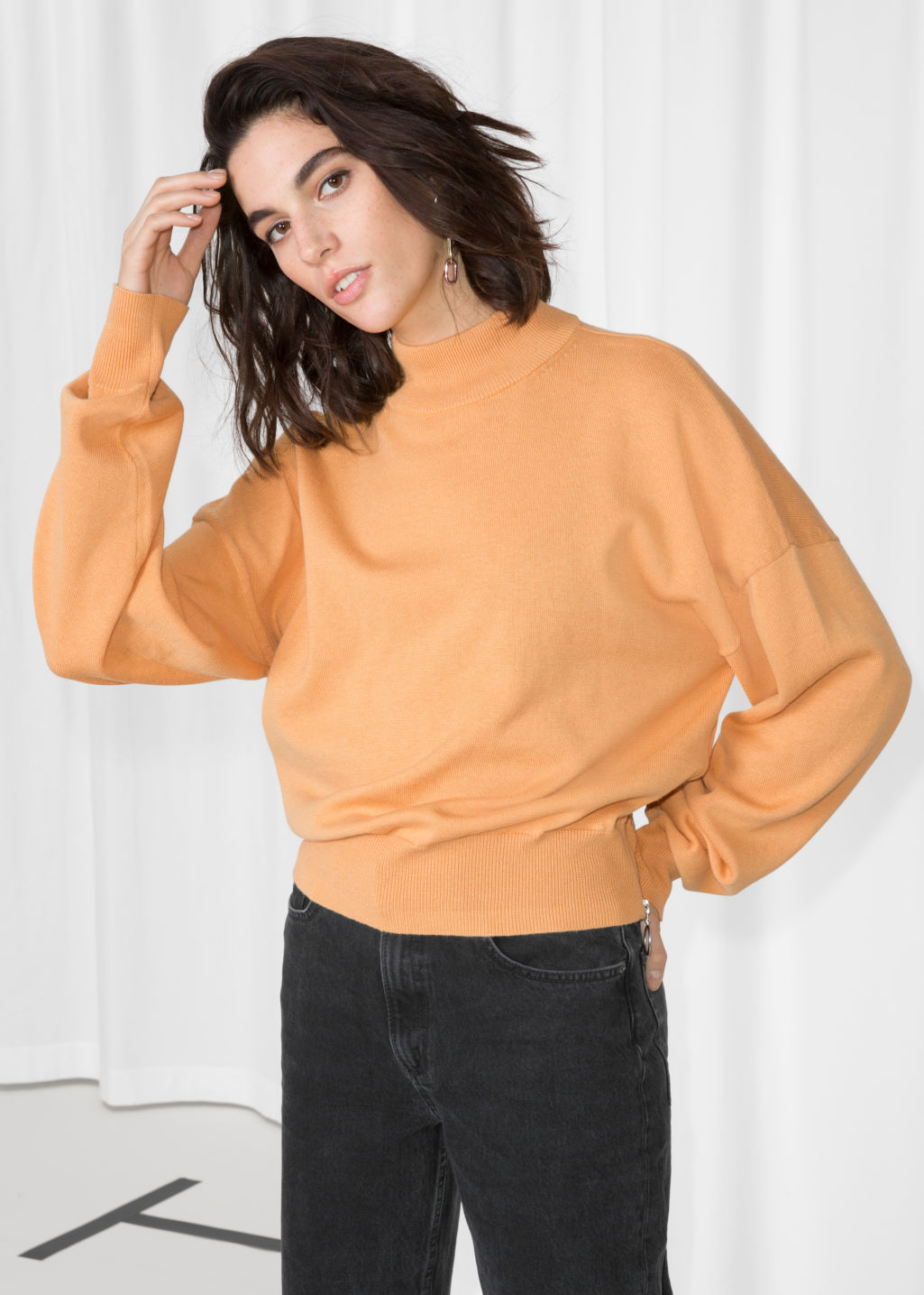 Model front image of Stories zip hip sweater in yellow