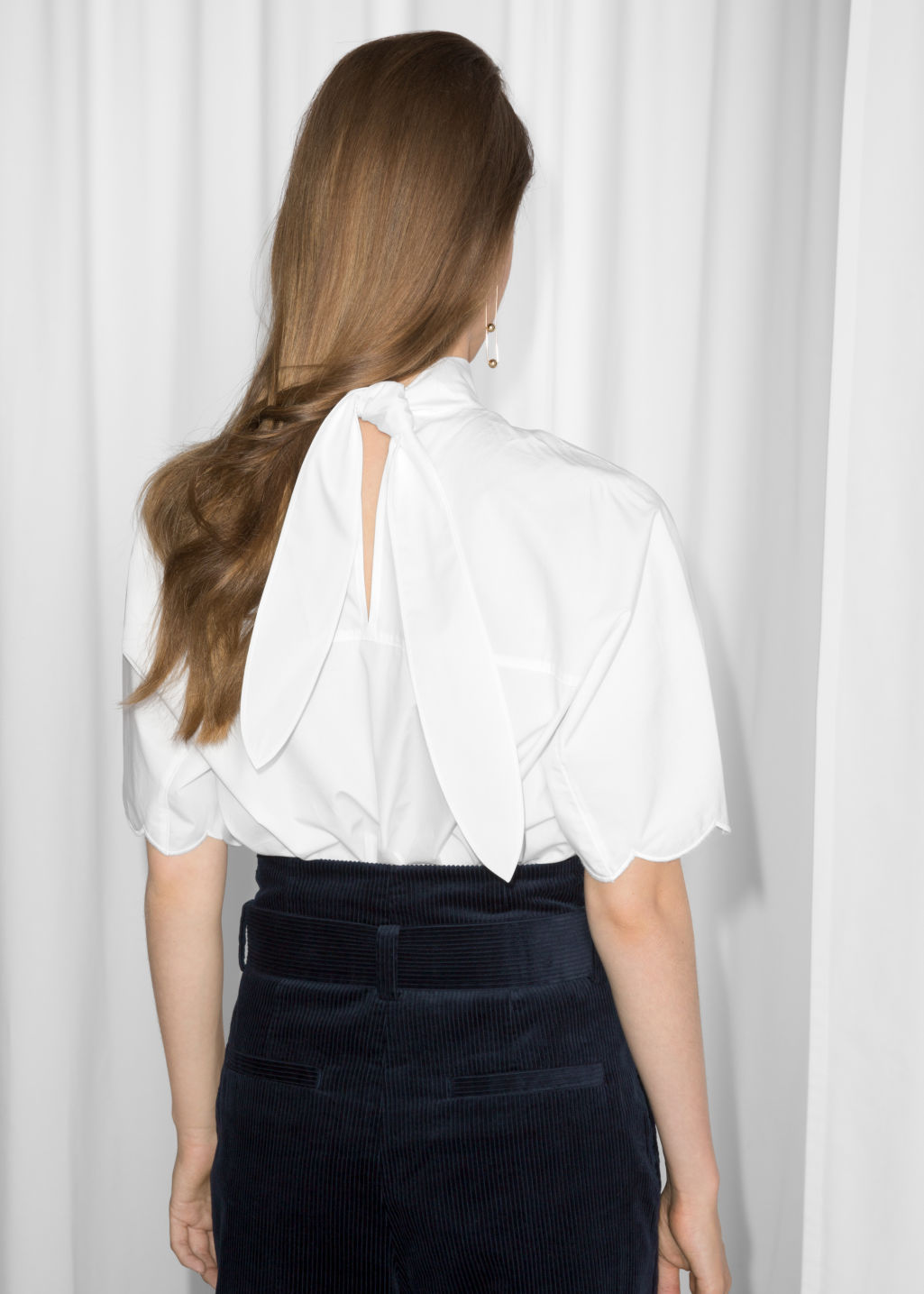 Model back image of Stories scallop hem blouse in white