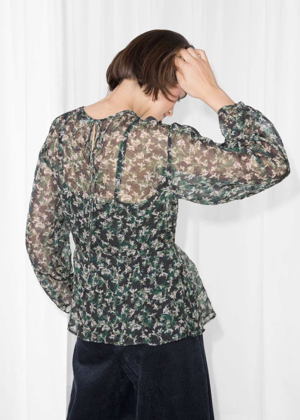 Model back image of Stories puff sleeve peplum blouse in green