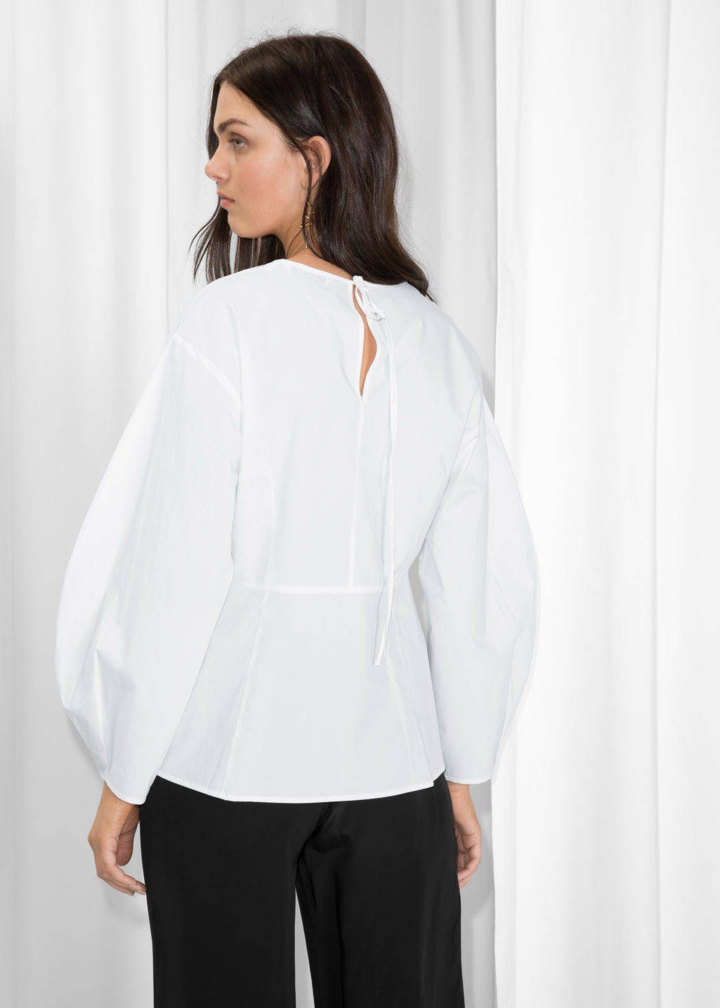 Model back image of Stories puff sleeve peplum blouse in white