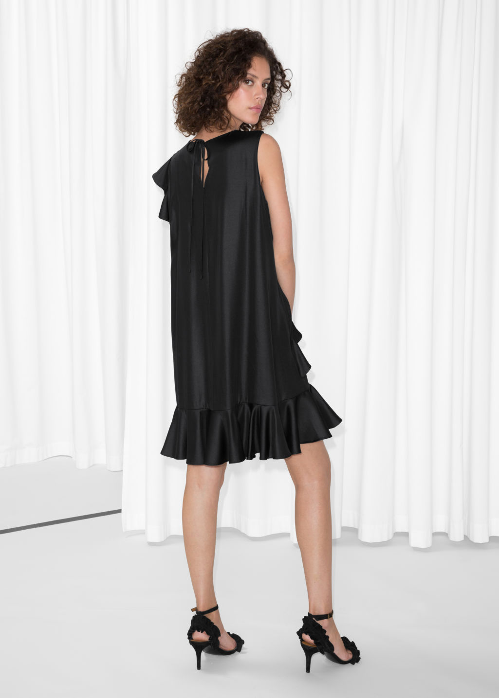 Model back image of Stories satin frill dress in black