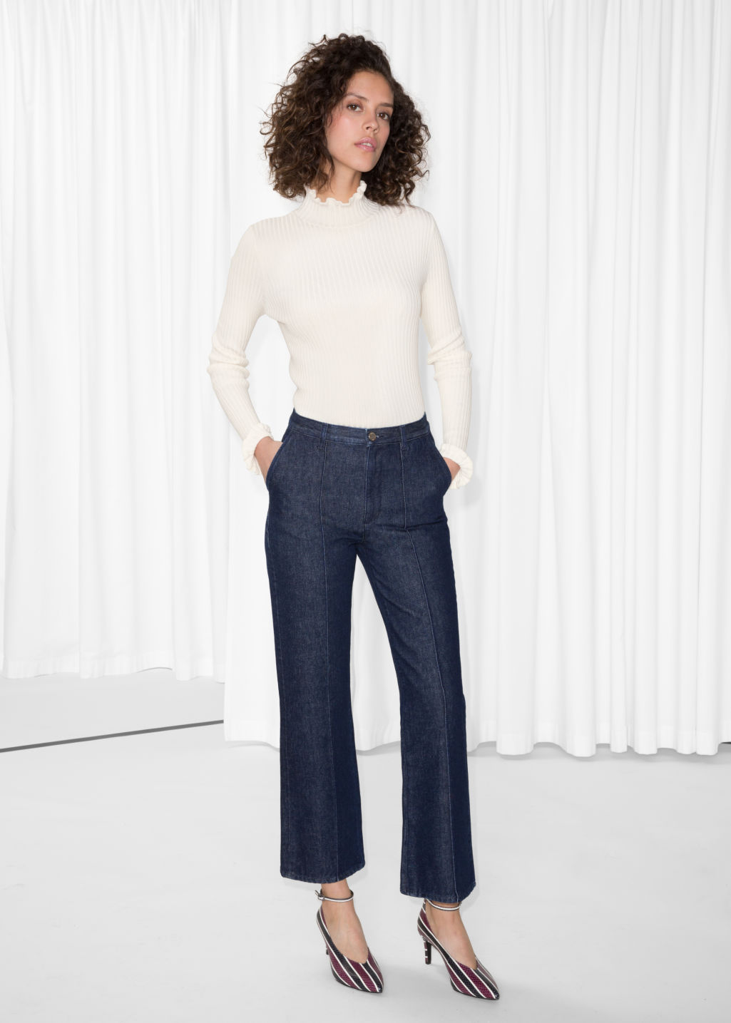 Model front image of Stories flare denim trousers in blue