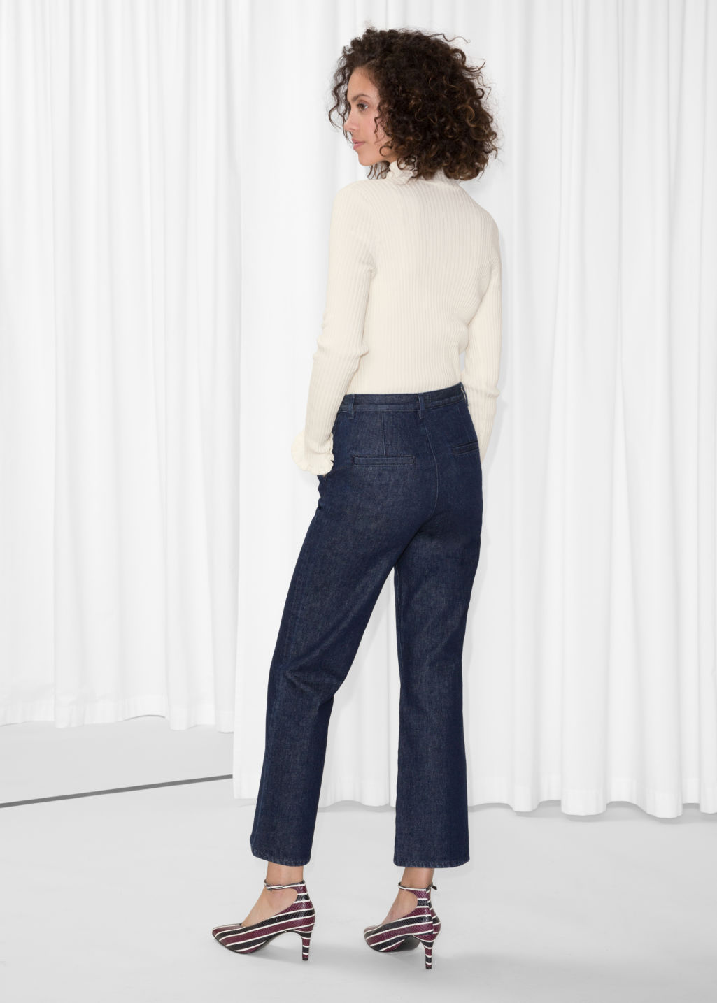 Model back image of Stories flare denim trousers in blue