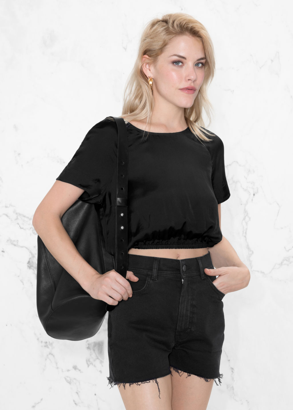 Model front image of Stories voluminous crop blouse in black