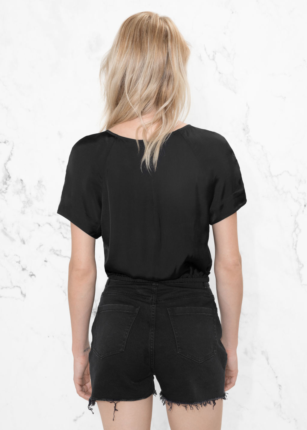 Model back image of Stories voluminous crop blouse in black