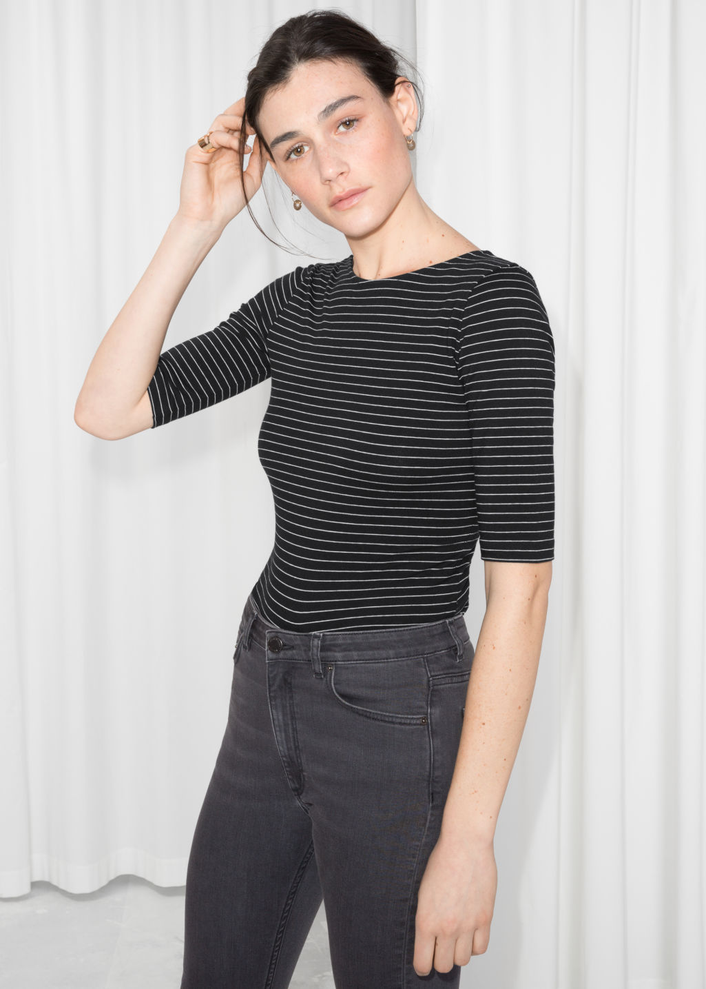 Model front image of Stories striped top in black