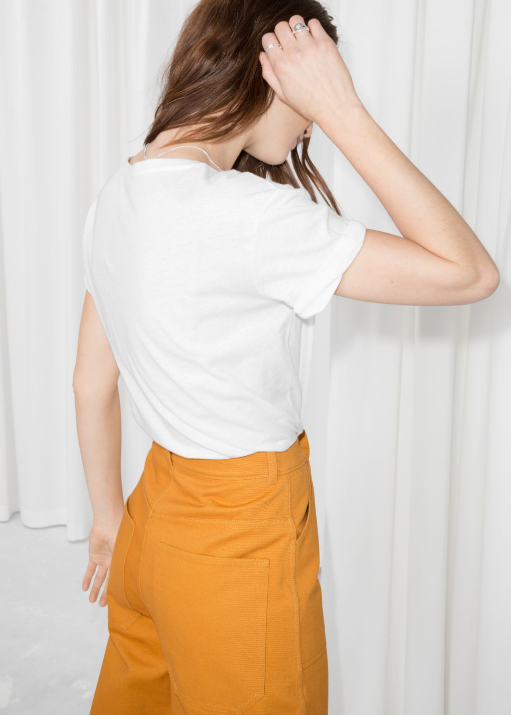 Model back image of Stories cotton tee in white