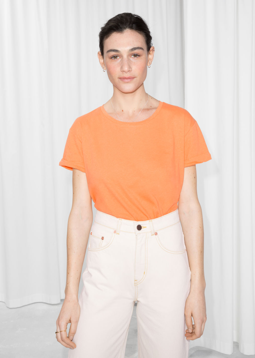 Model front image of Stories cotton tee in orange