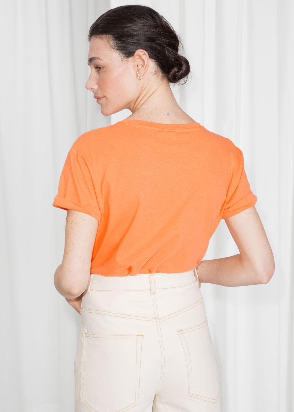 Model back image of Stories cotton tee in orange