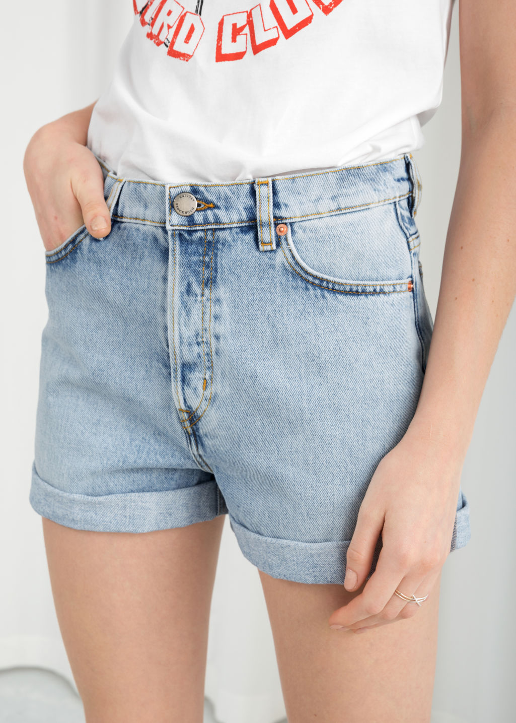 Model back image of Stories denim mini shorts in blue