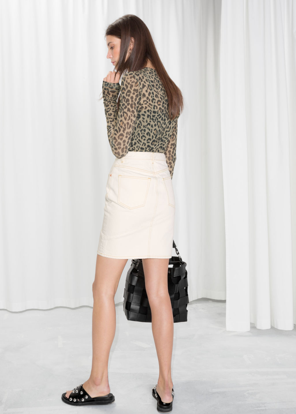 Model back image of Stories denim pencil skirt in white
