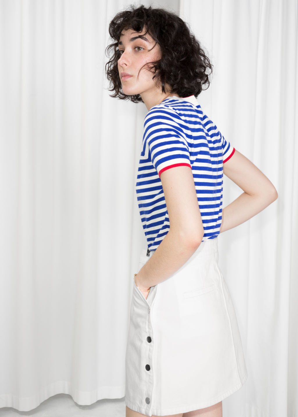 Model back image of Stories striped sweater in white