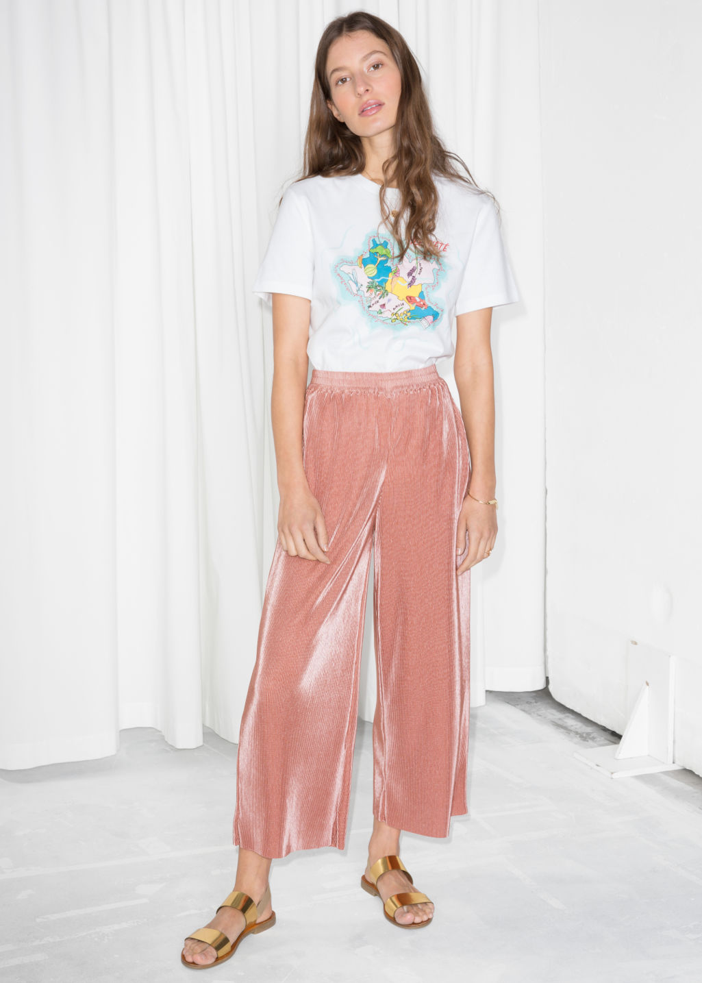 Model front image of Stories pleated metallic trousers in orange
