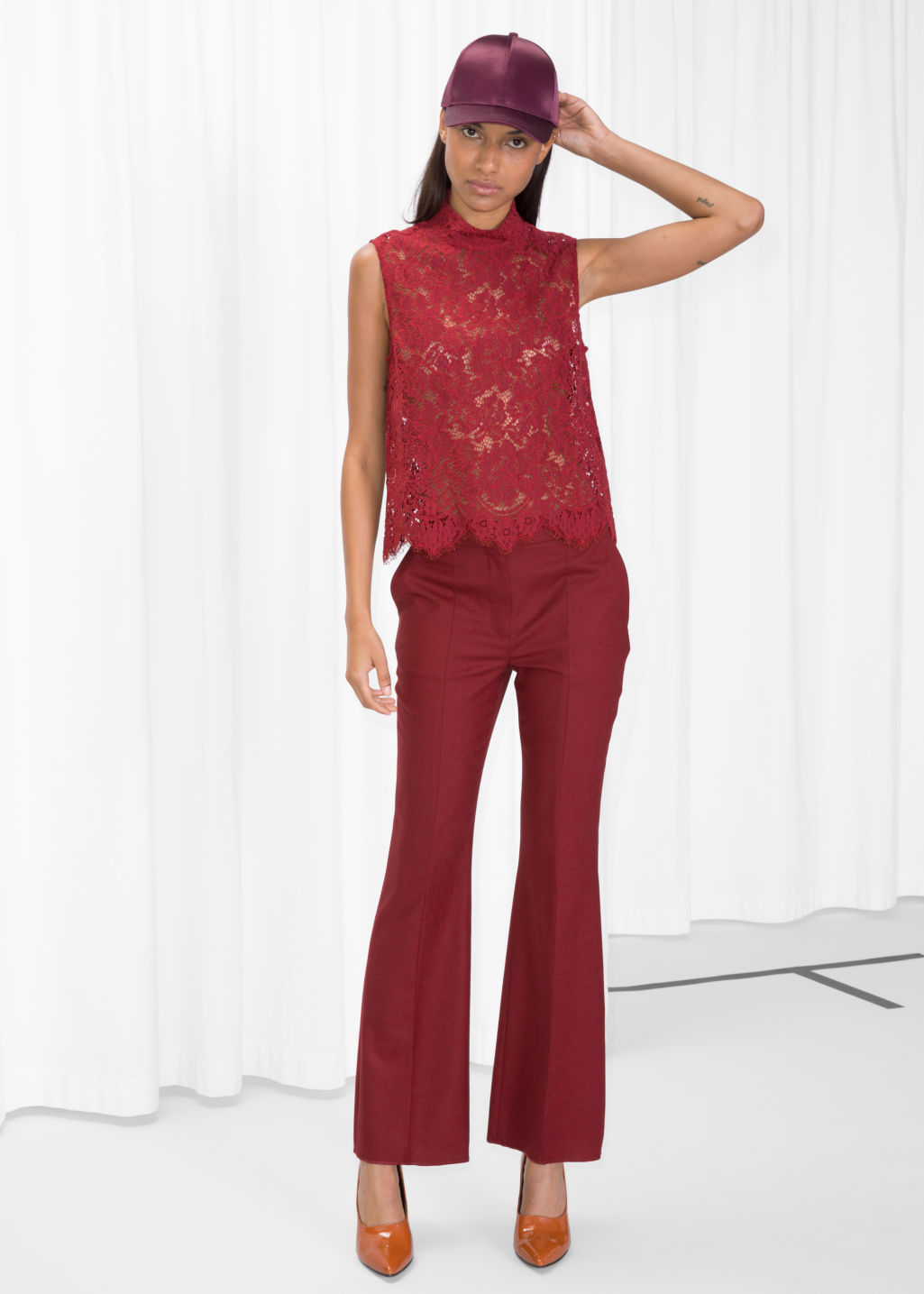 Model front image of Stories crease wool trousers in red