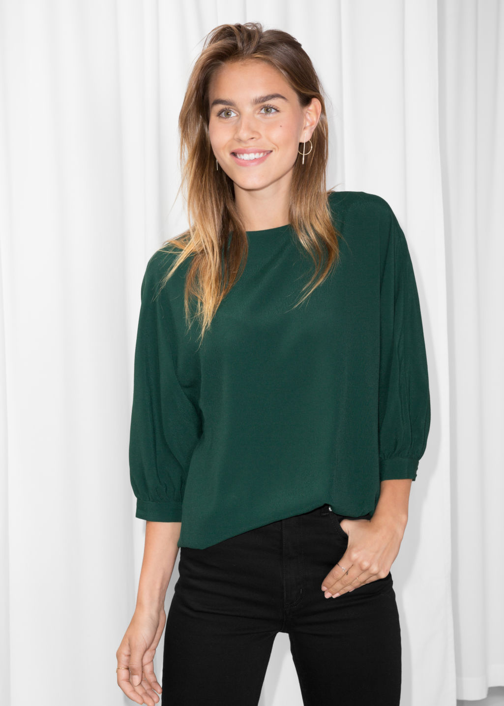 Model front image of Stories puff sleeve blouse in green