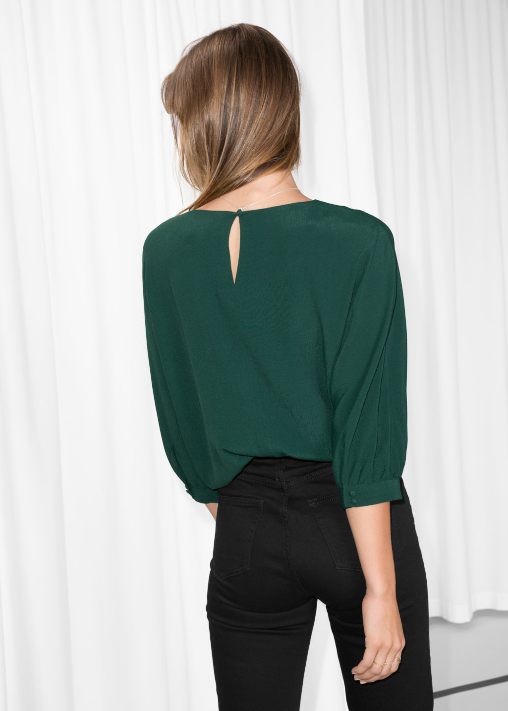 Model back image of Stories puff sleeve blouse in green