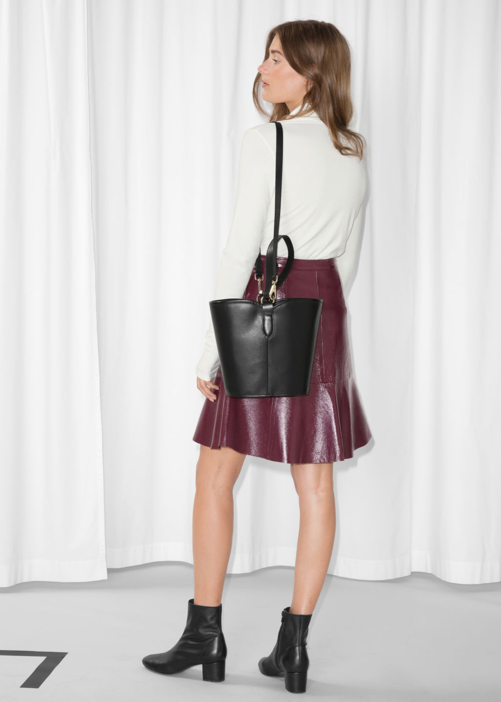 Model back image of Stories frill leather skirt in red