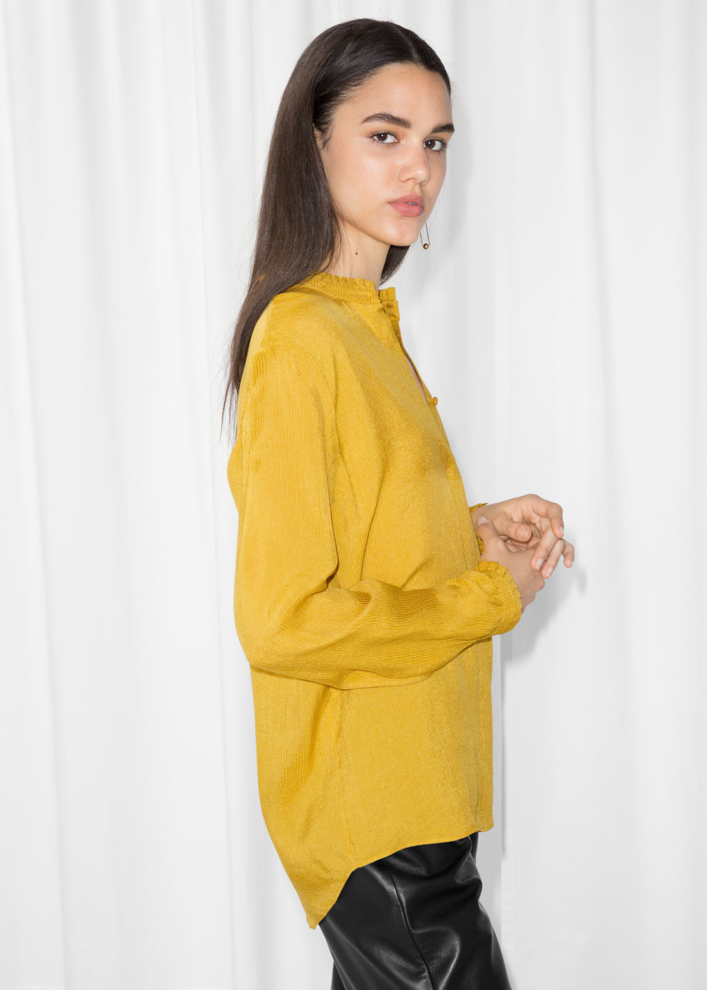 Model front image of Stories pleat frill neck blouse in yellow