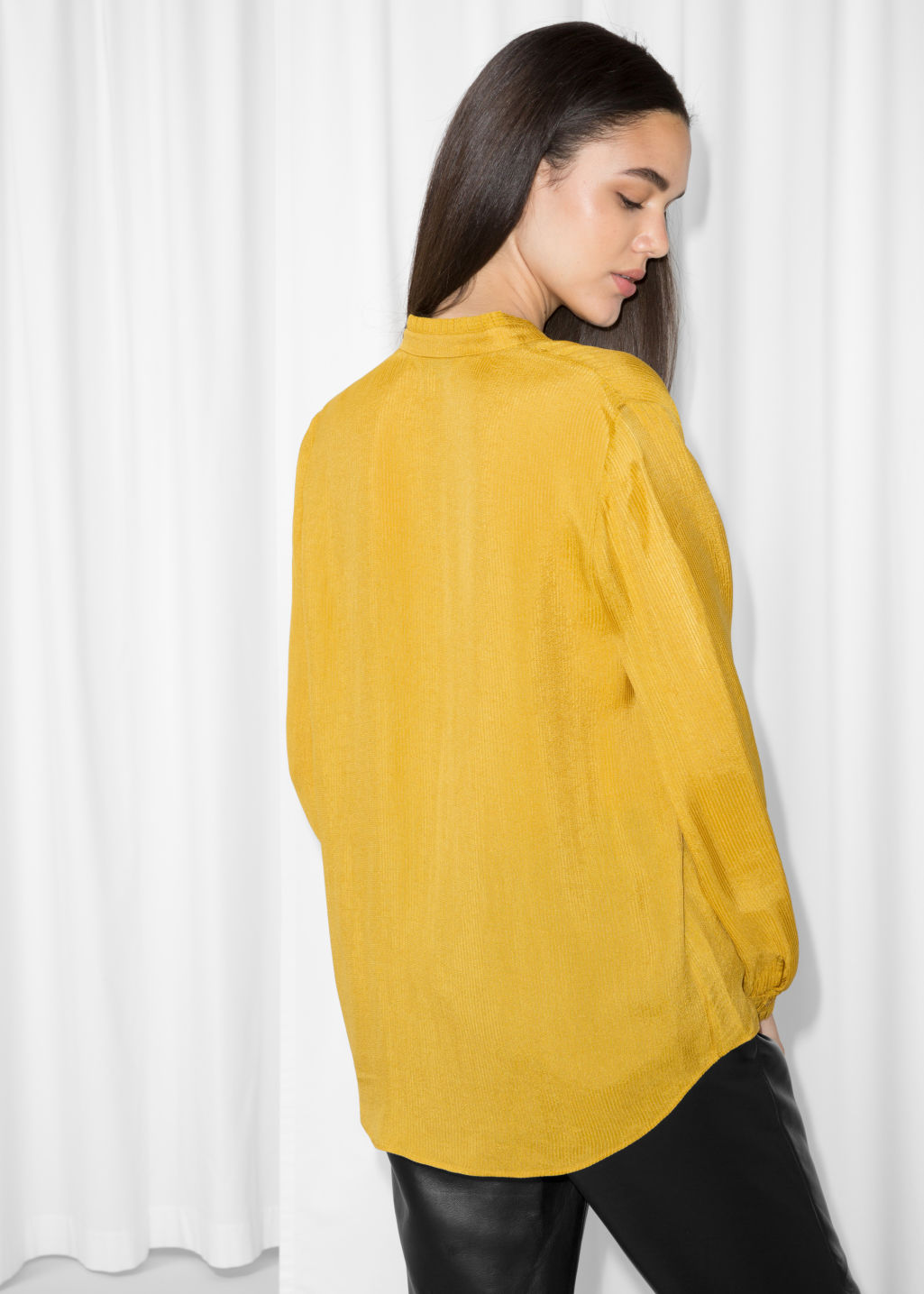 Model back image of Stories pleat frill neck blouse in yellow