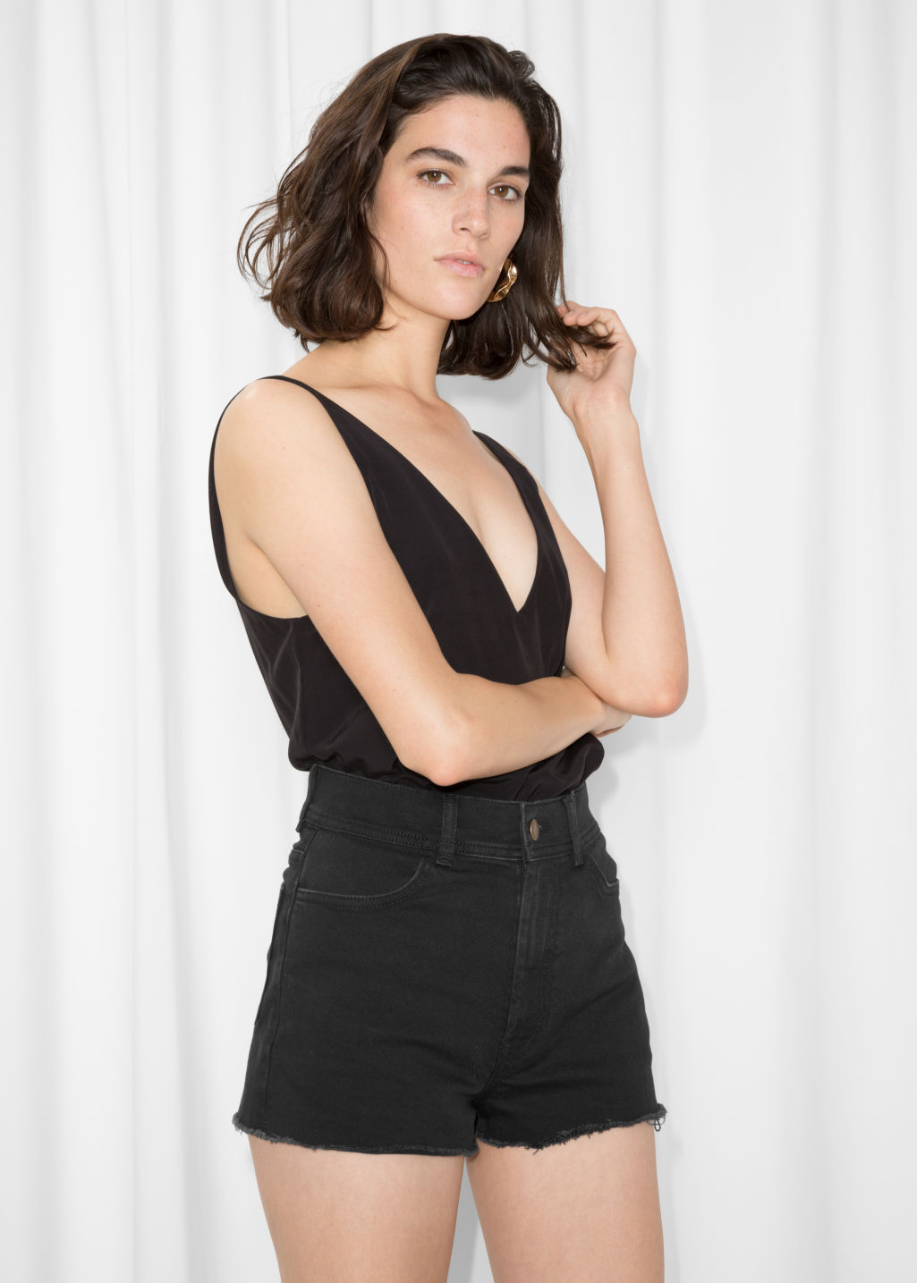 Model front image of Stories high waisted denim shorts in black