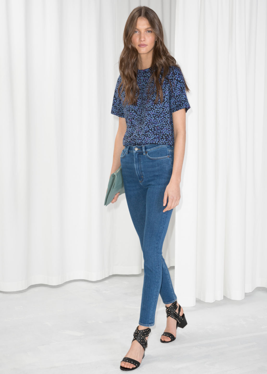 Model front image of Stories high-waist denim jeans in blue
