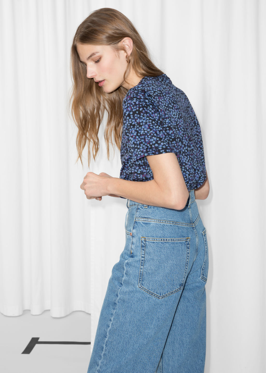 Model back image of Stories floral cotton top in blue