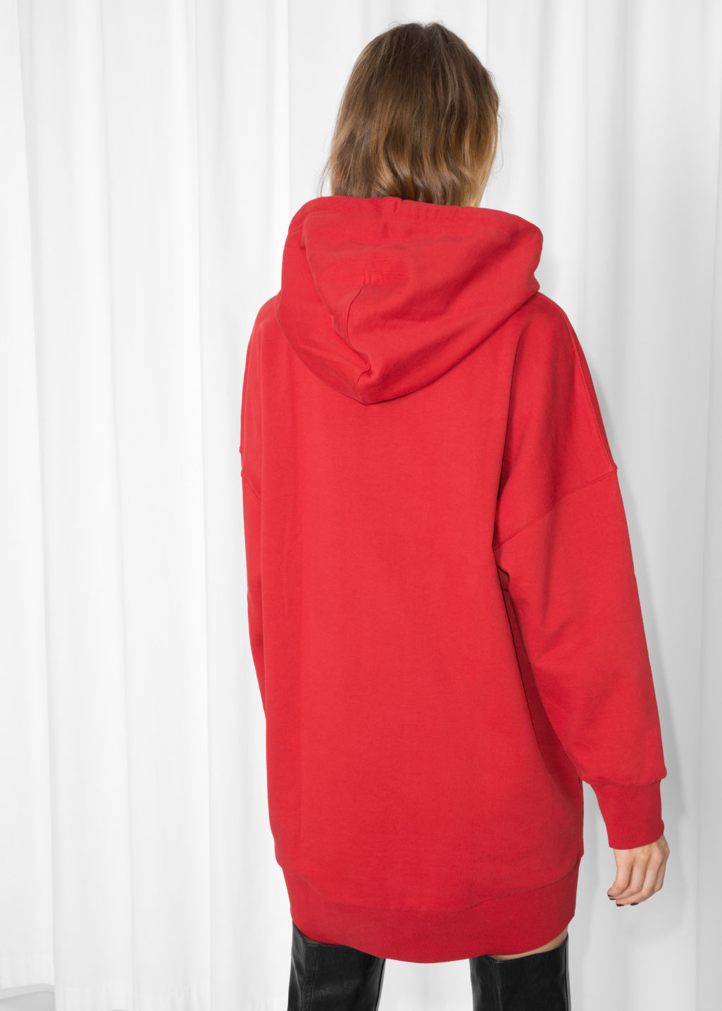 Model back image of Stories oversized hoodie dress in red