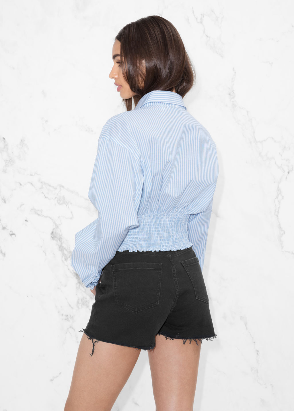 Model back image of Stories tie blouse in blue