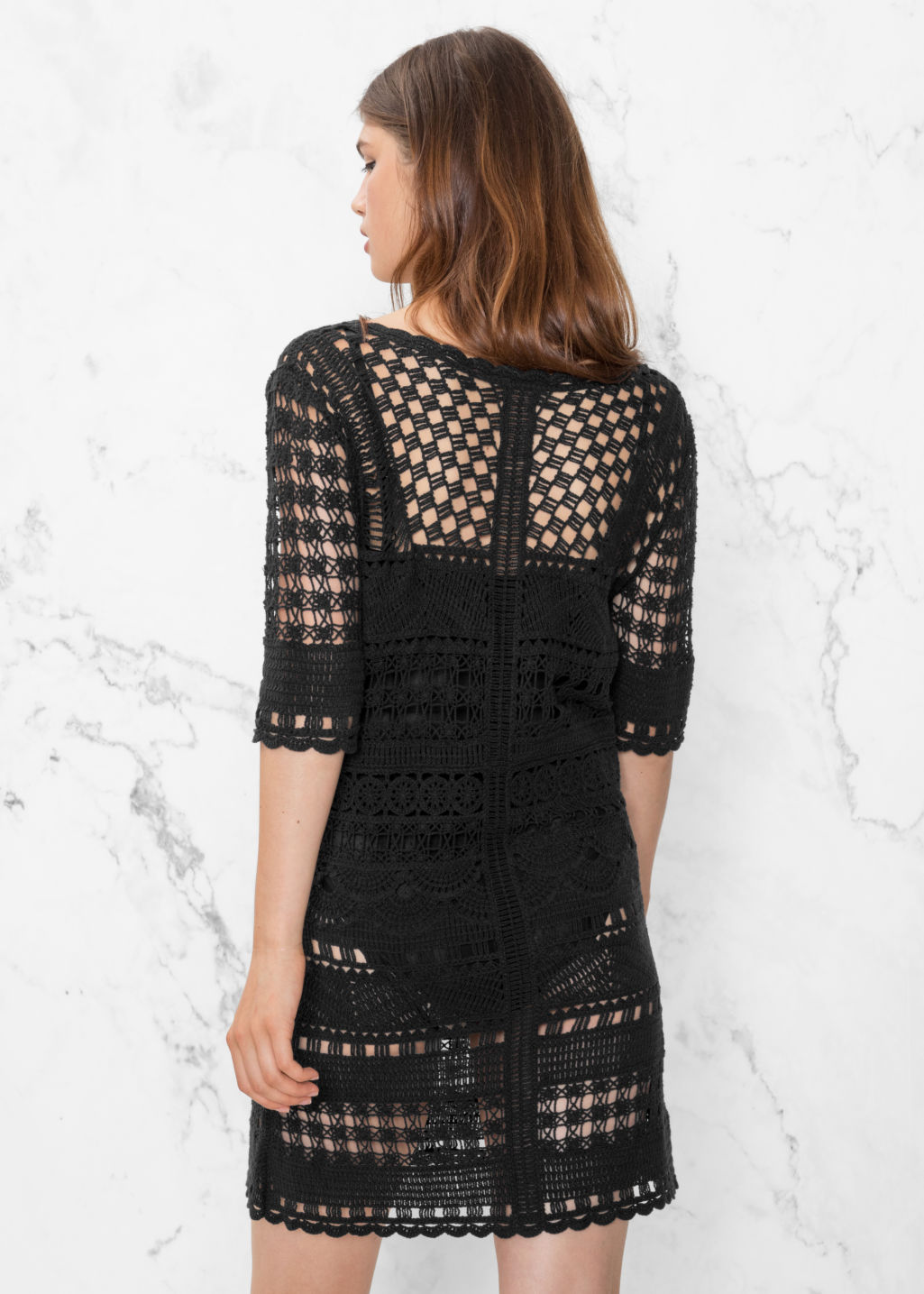 Model back image of Stories crochet dress in black