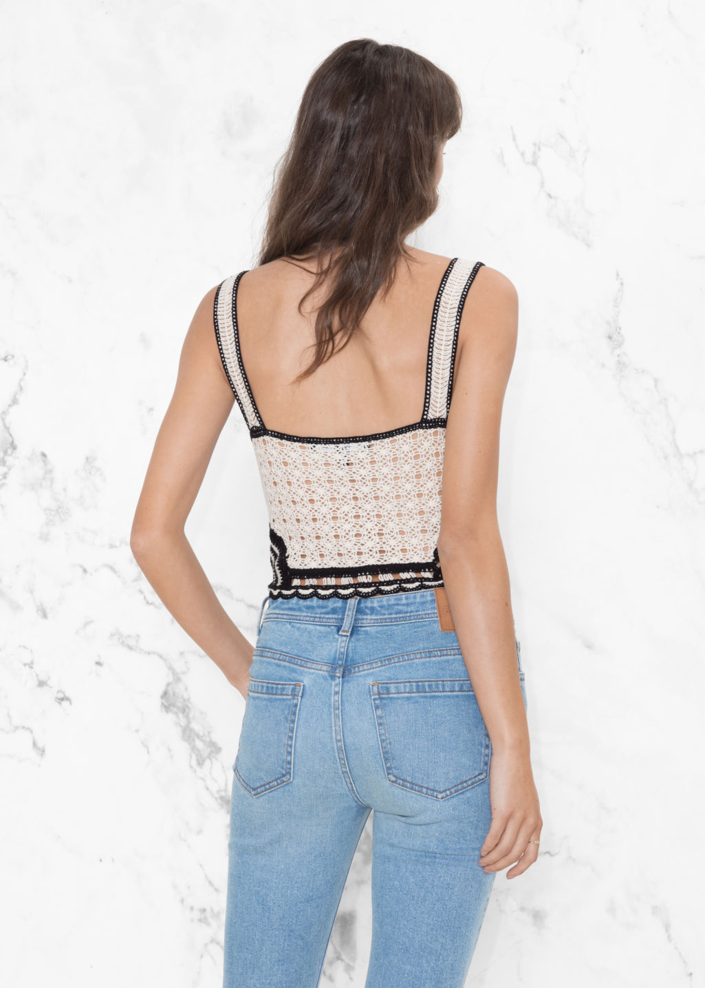 Model back image of Stories crochet crop top in white