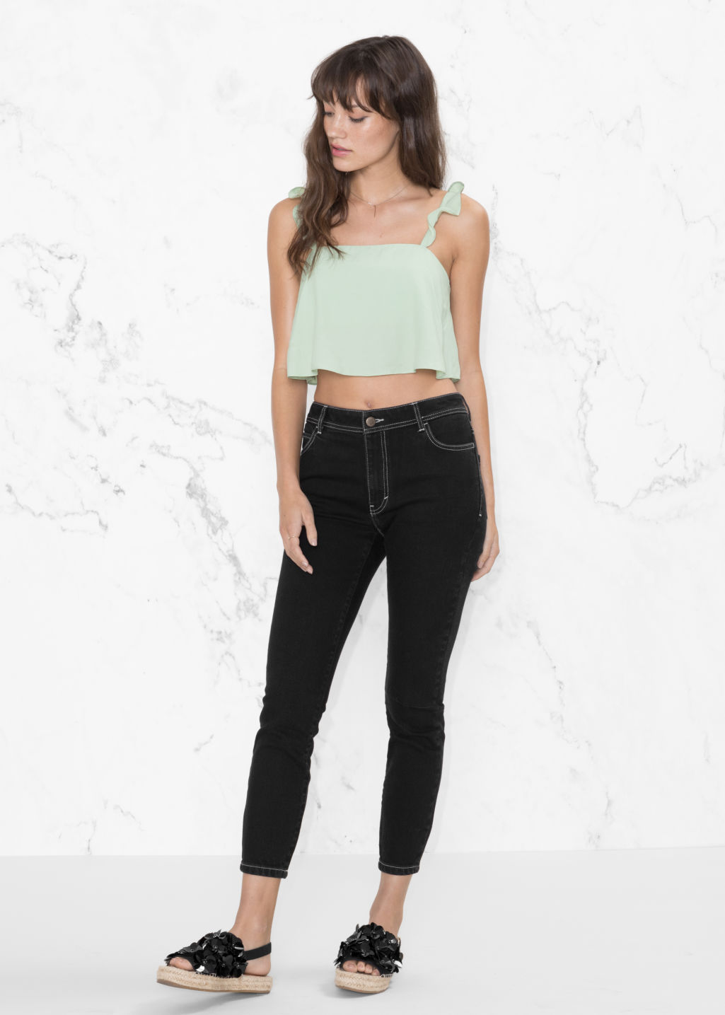 Model front image of Stories cropped denim jeans in black