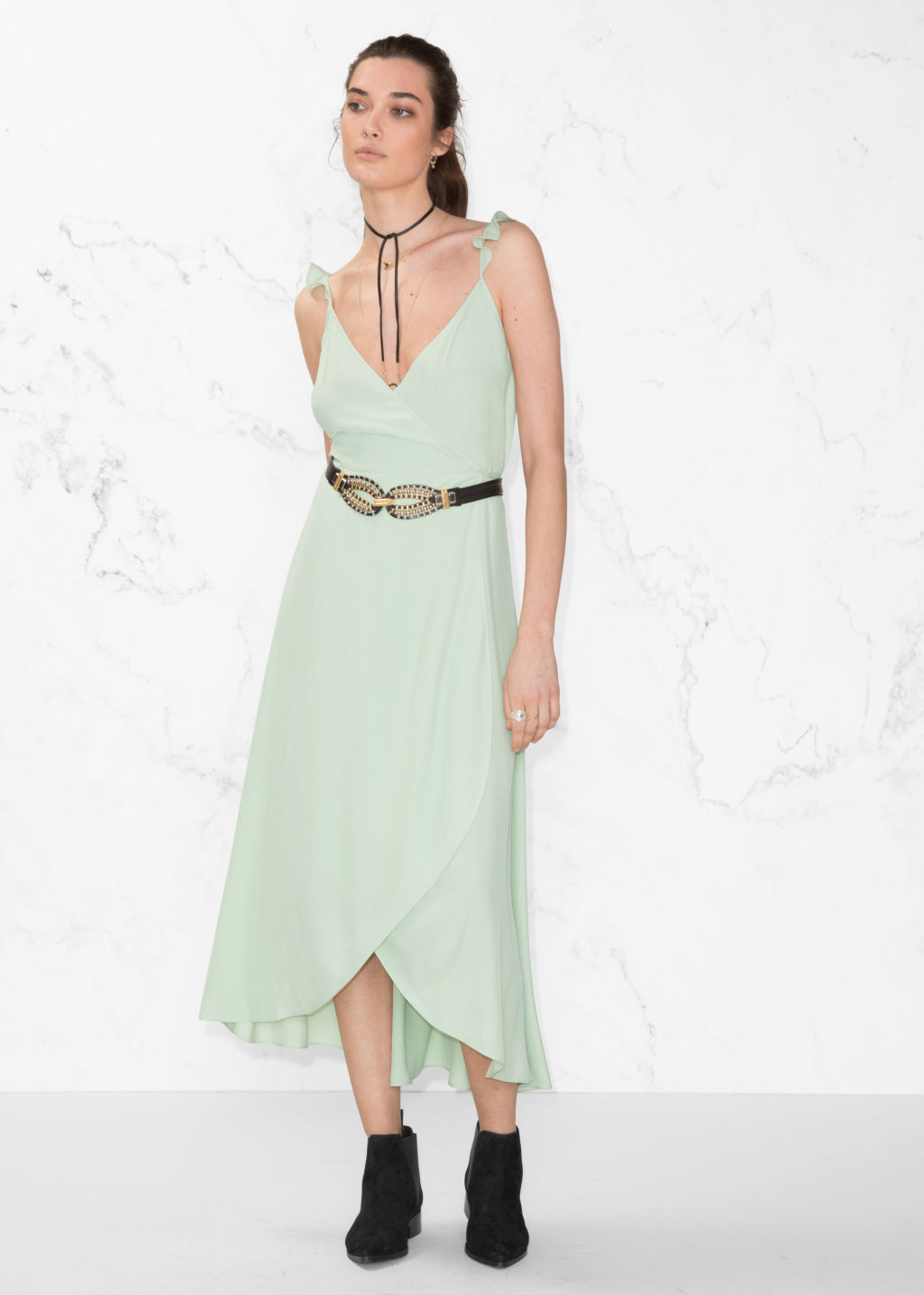 Model front image of Stories wrap dress in green
