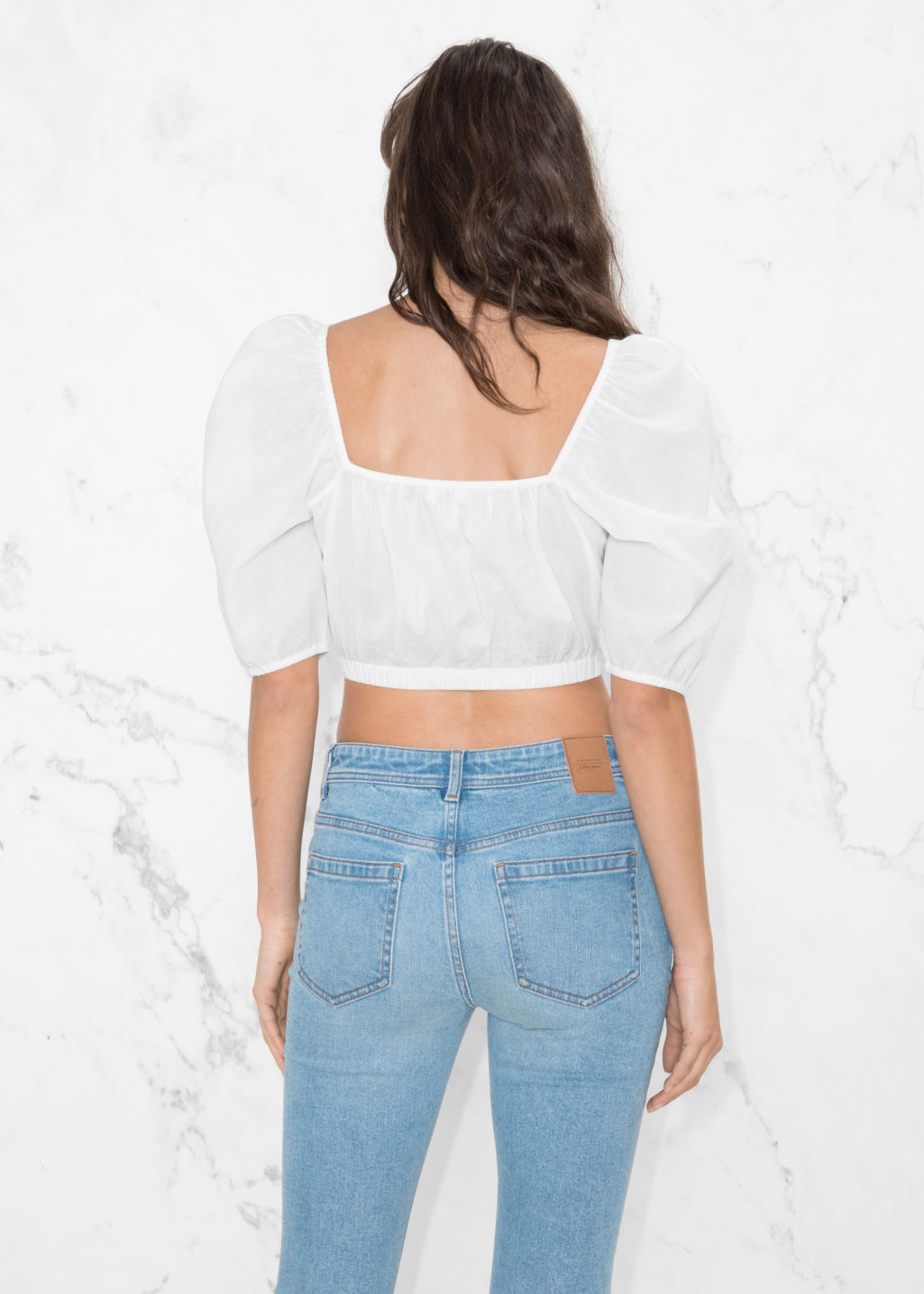Model back image of Stories voluminous crop blouse in white
