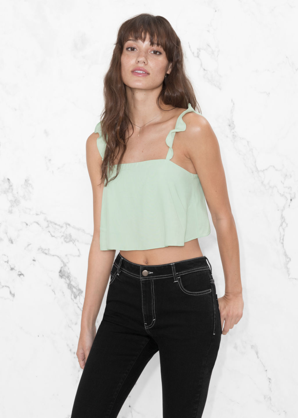 Model front image of Stories frill strap crop top in green