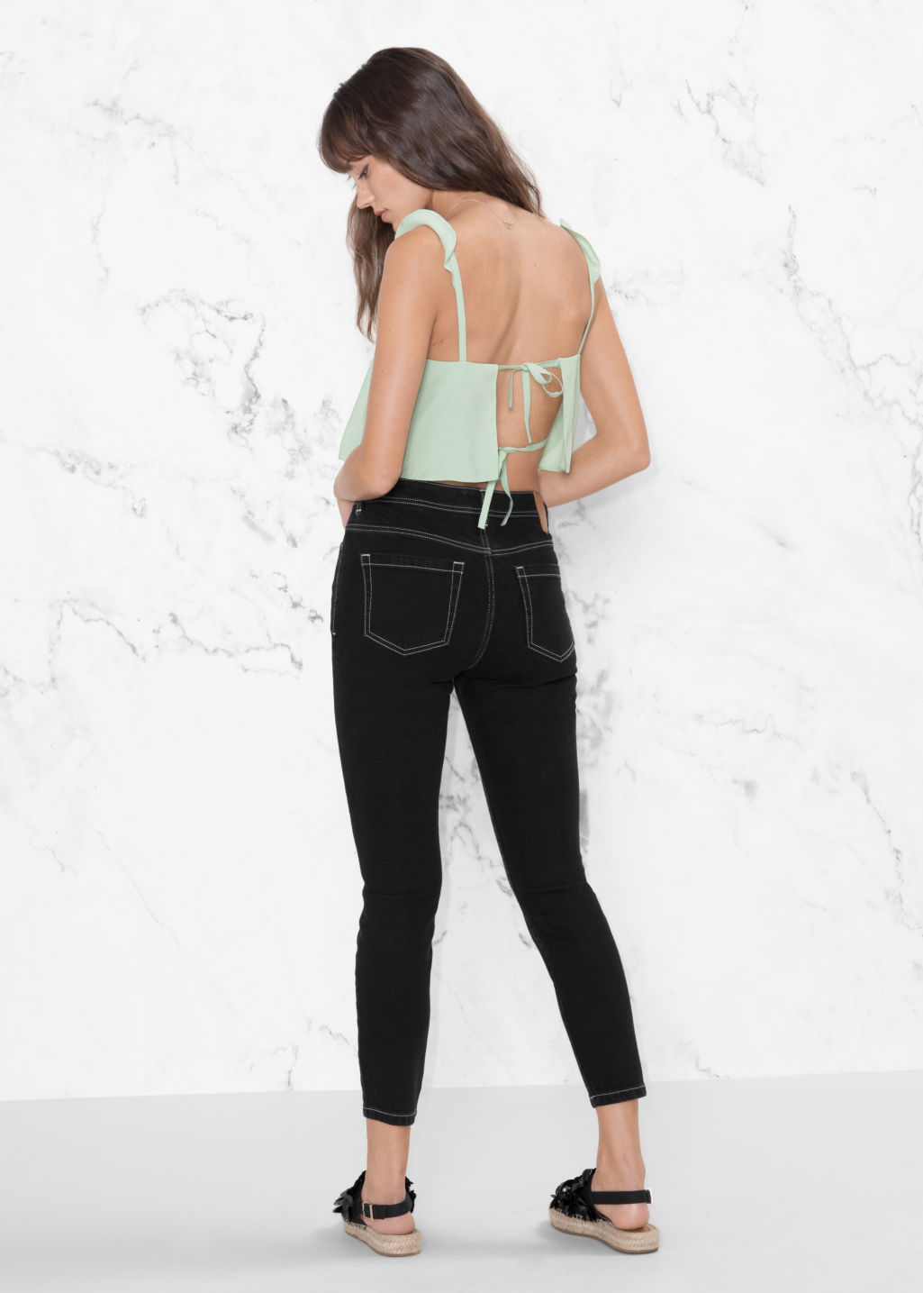 Model back image of Stories frill strap crop top in green